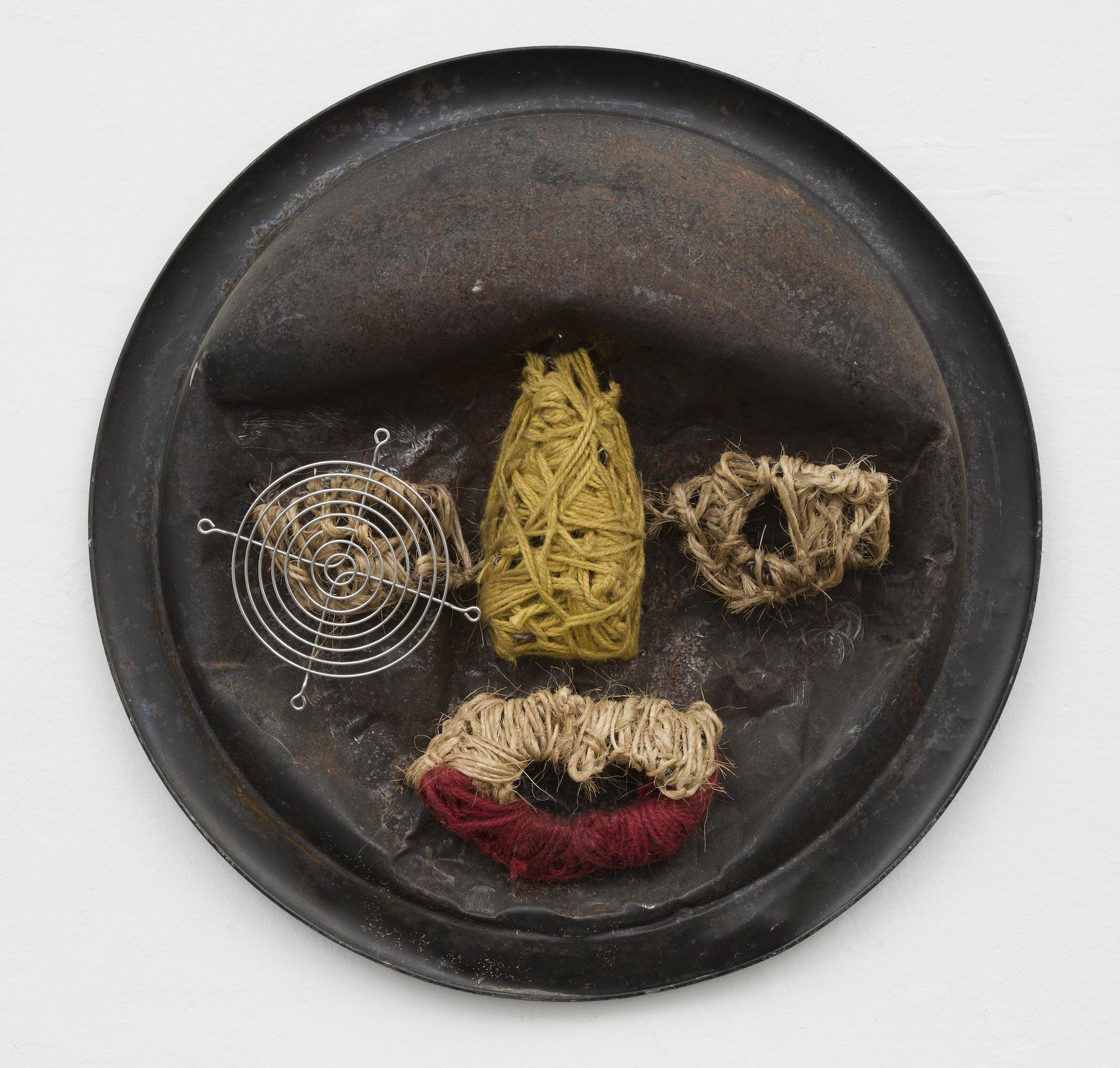 Sangalyambogo, (Favorite Daughter of The King of Buganda), 2016, Metal, twine, yarn and found objects, 20 (diameter) x 3 in, courtesy Gordon Robichaux.jpg