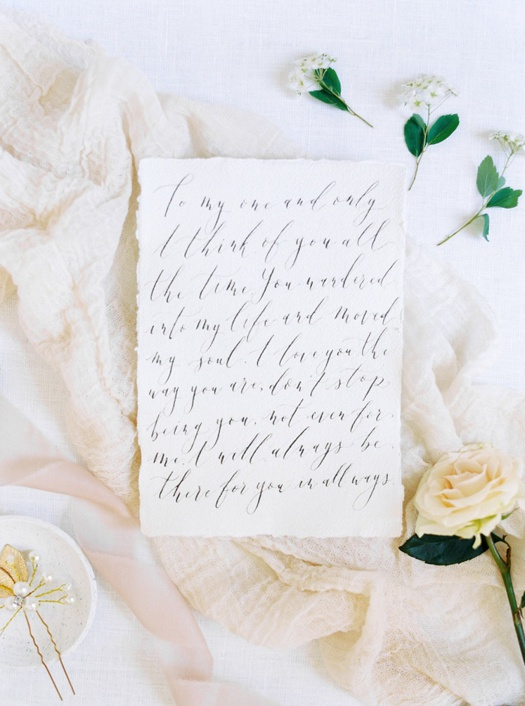 Handwritten love letter on handmade paper.