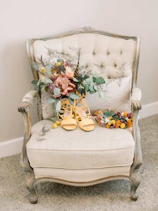 Bride's wedding day accessories on a chair