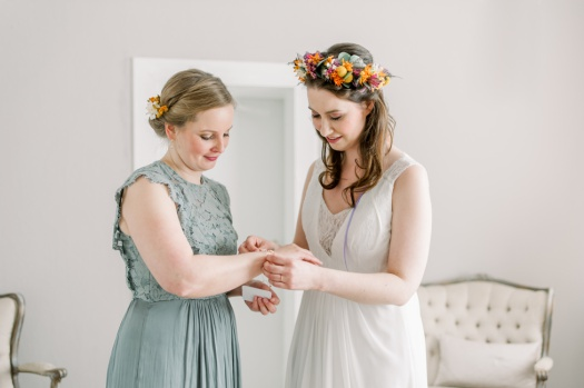 Sweet moment between the bride and her maid of honour