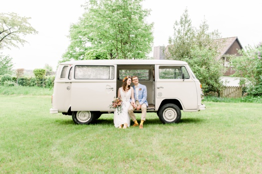 Bride and groom photos in a VW minivan