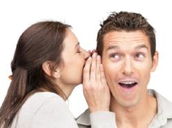 Girl lady woman whispering to boy guy man whisper telling secrets secret pay off debt invest financial literacy