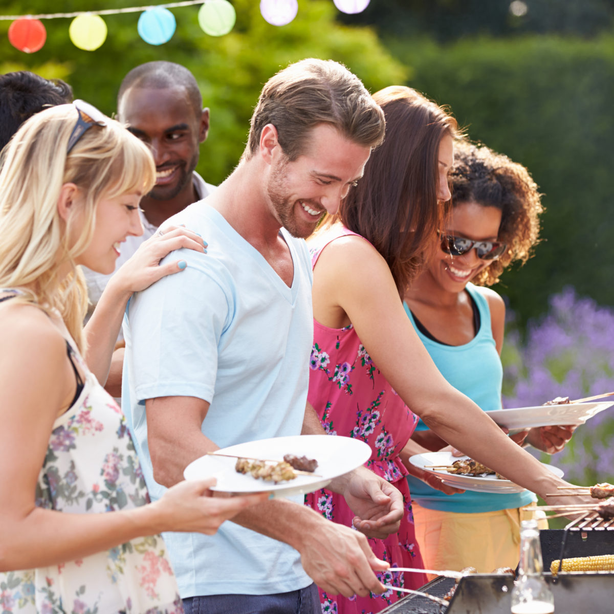 Host an Epic Backyard Shindig on a Tight Budget People BBQing BBQ Party Budgeting Affordable
