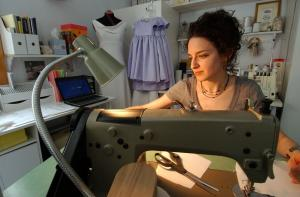 Shaline at Sewing Machine, photo by Jeb Wallace-Brodeur