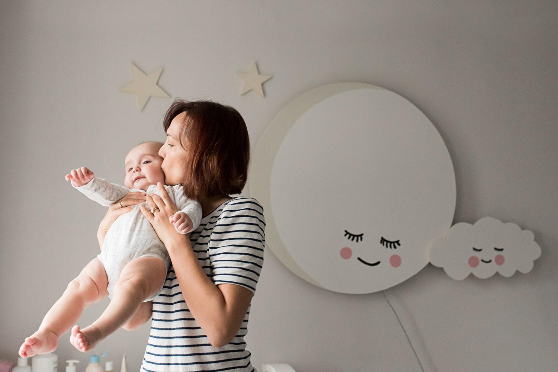 mum-holds-baby-nursery.jpg