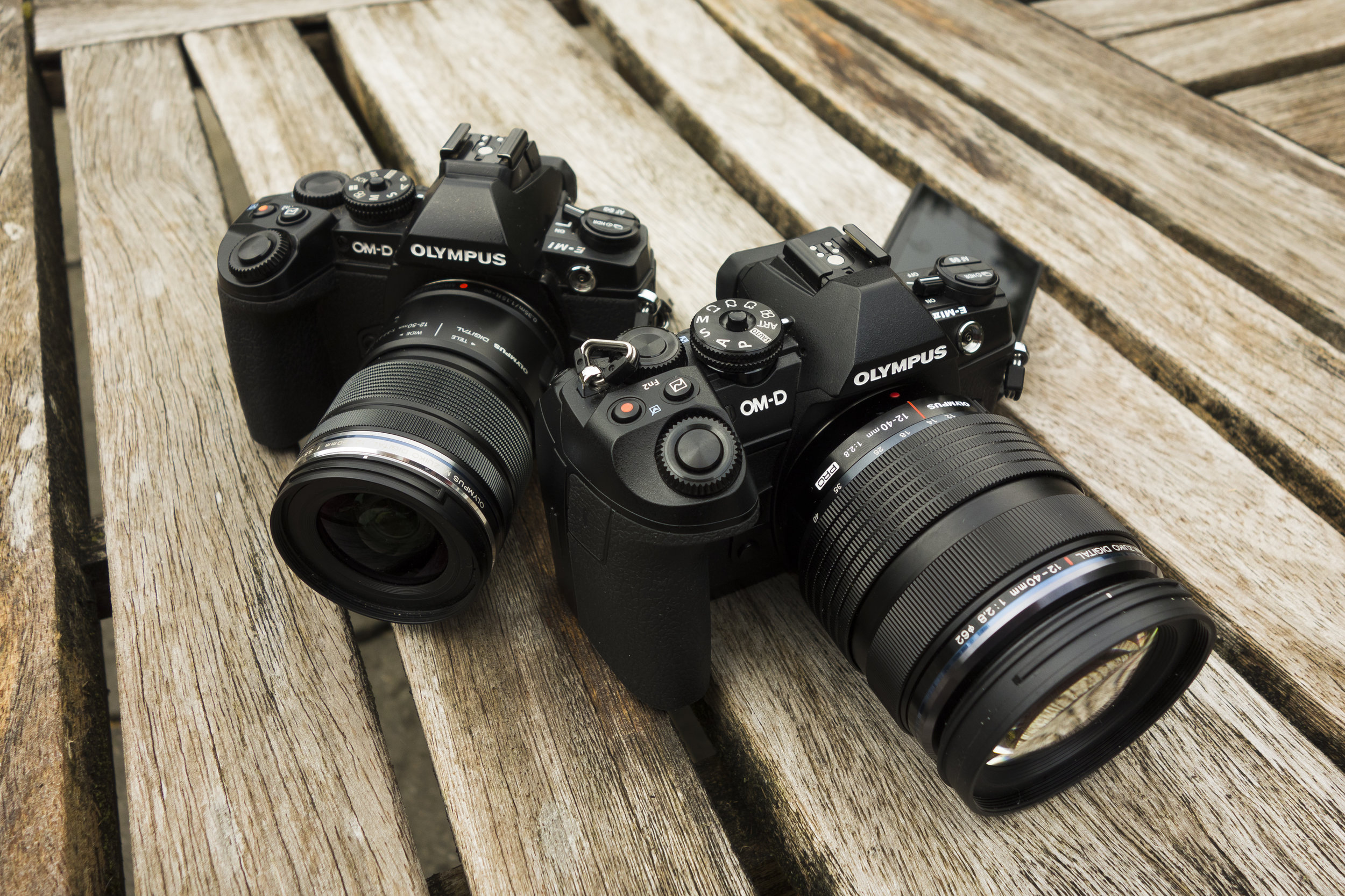 The Olympus OM-D E-M1 Mark II review sample sitting alongside my own Olympus OM-D E-M1