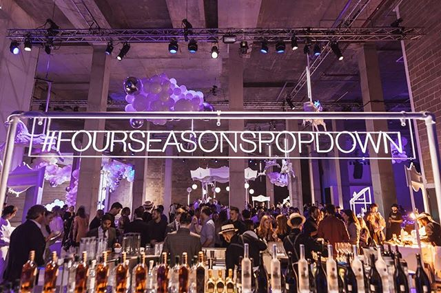 """Last week, #FourSeasonsPopDown officially landed in London. A two-night experience saw Camden Town's Hawley Wharf Basement transformed into an """"underground playground"""", setting the scene for an unexpected journey of the senses, complete with a rotating carousel bar, swings lit by LED lights, and an all-white bouncy castle. With this came signature sips and culinary delights from 15 acclaimed @FourSeasons chefs and mixologists, visiting from eight countries across the globe. Two contrasting events saw the venue become the background to a host of VIP guests who enjoyed a DJ set from British duo, Disclosure, on Thursday night and a cozy cinema screening of the childhood classic movie, Big, on Friday which was open to the public."""