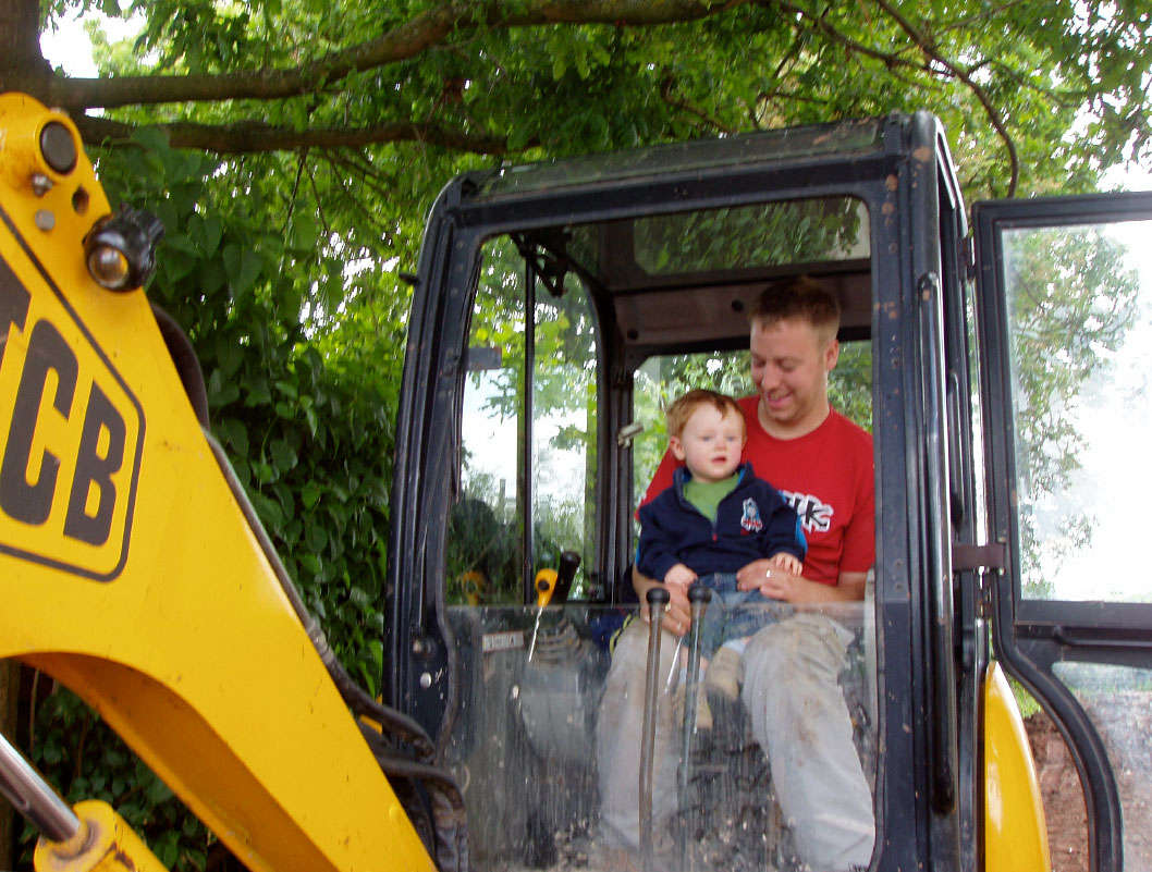 adam with son in digger