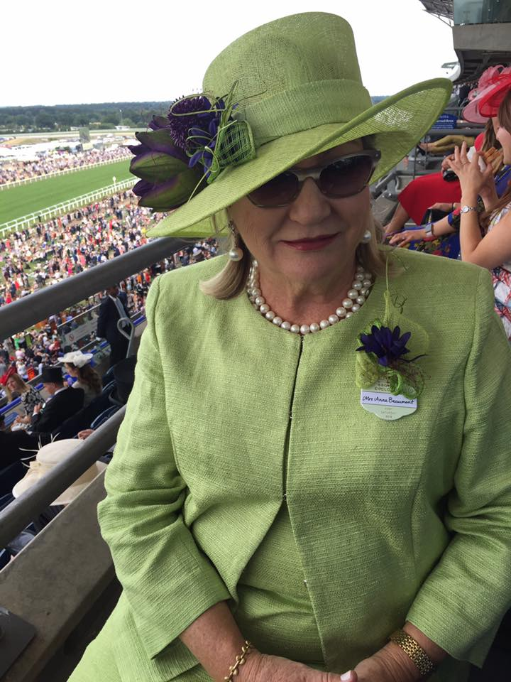 Our client Anna Beaumont wearing one of our hats with a matching corsage and Marina Rinaldi outfit. Doesn't it look lovely on her?