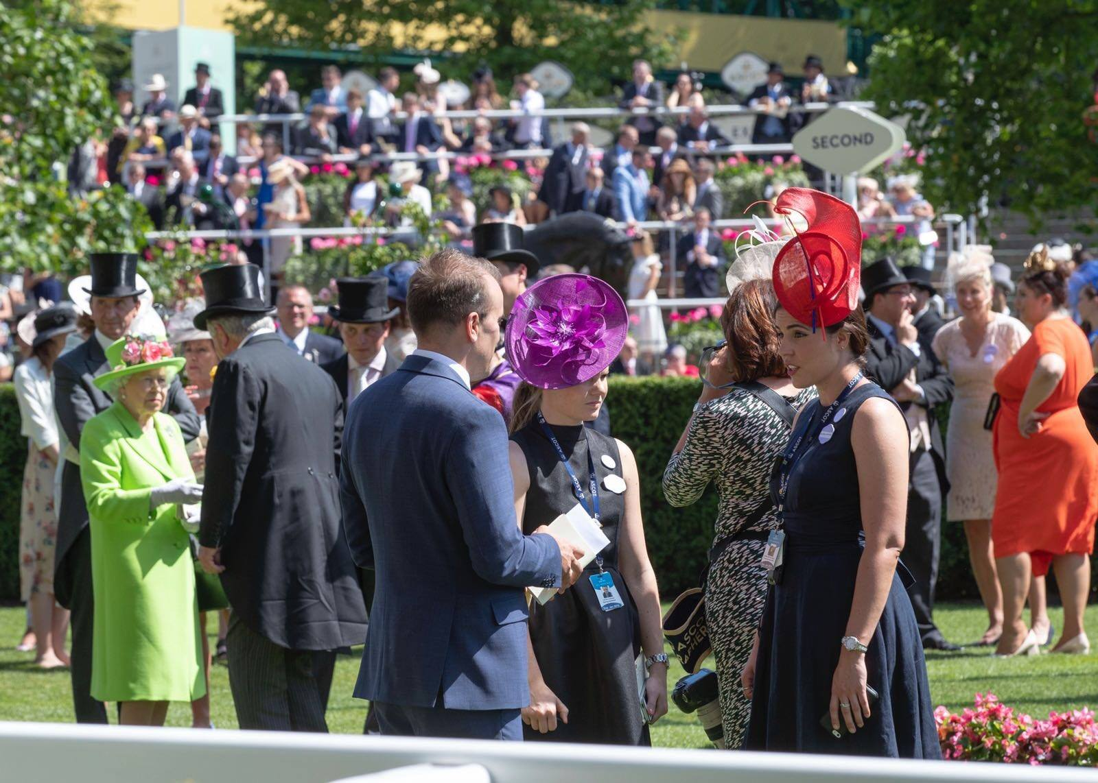 Ashley Morton Hunte wearing a Katherine Elizabeth Milinery red hat during Royal Ascot, looking after the Royal Family.