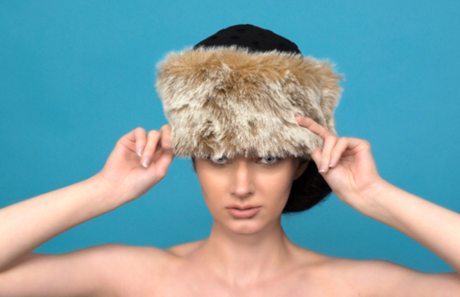 This winter headpiece is inspired from a Russian woman's style made with felt and luxury faux fur.