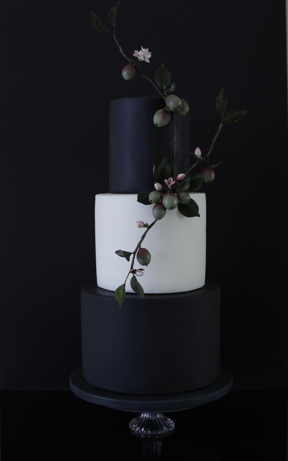 plumb and blossom wedding cake