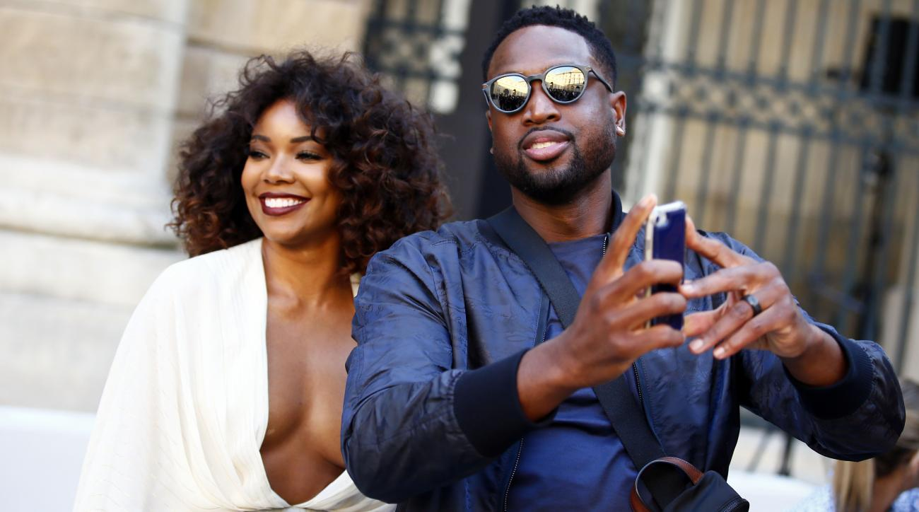 Gabrielle Union-Wade and Dwyane Wade in Paris for fashion week.