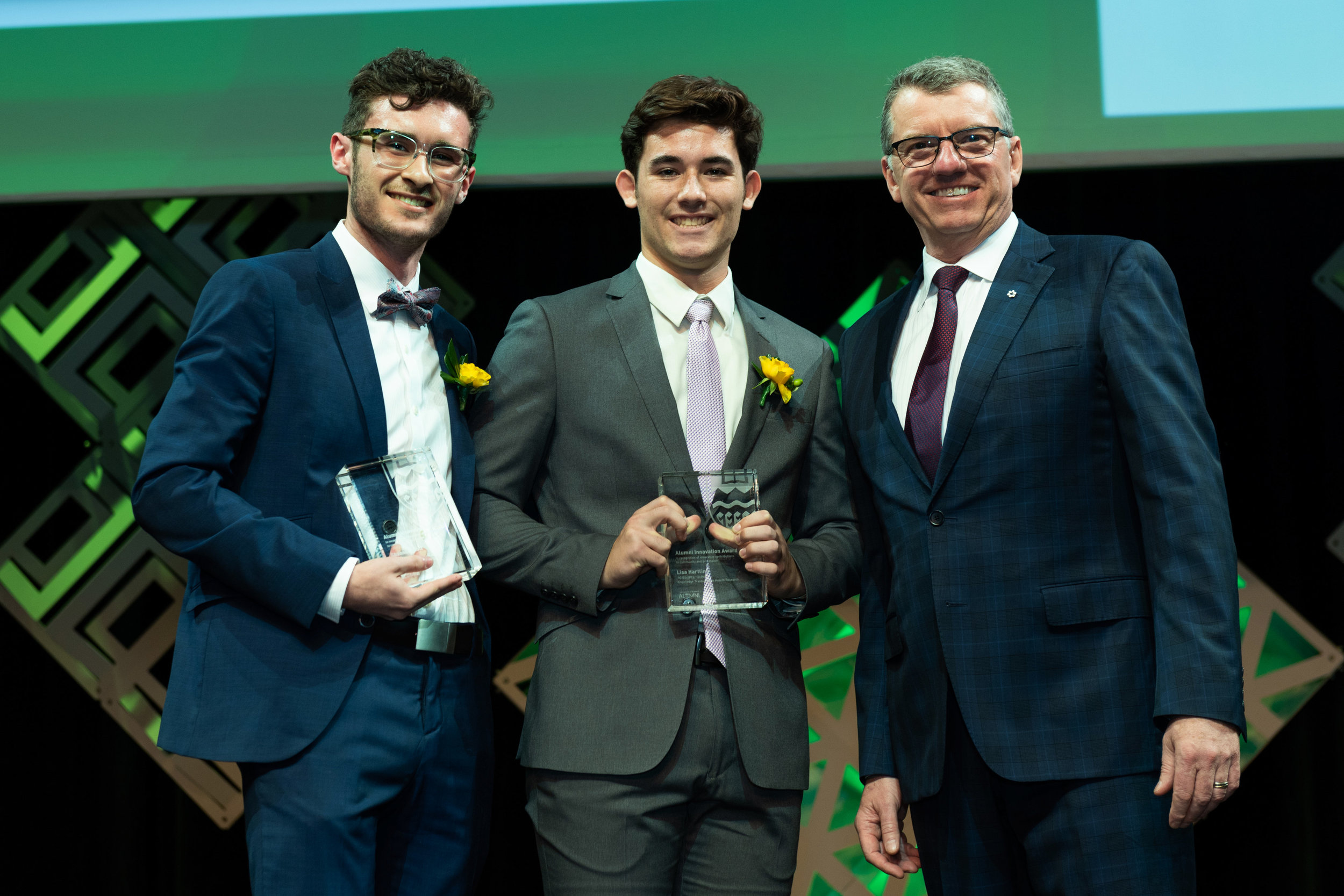The children of Drs. Scott and Hartling collecting the University of Alberta 2018 Alumni Innovator of the Year Award, on their behalf.
