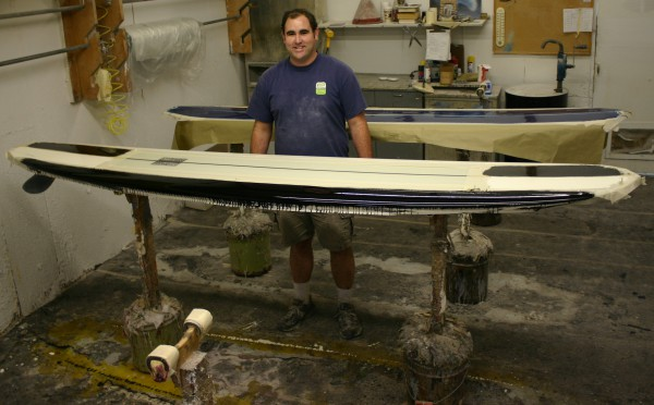 Adam laying down the ICBM-themed resin panels.