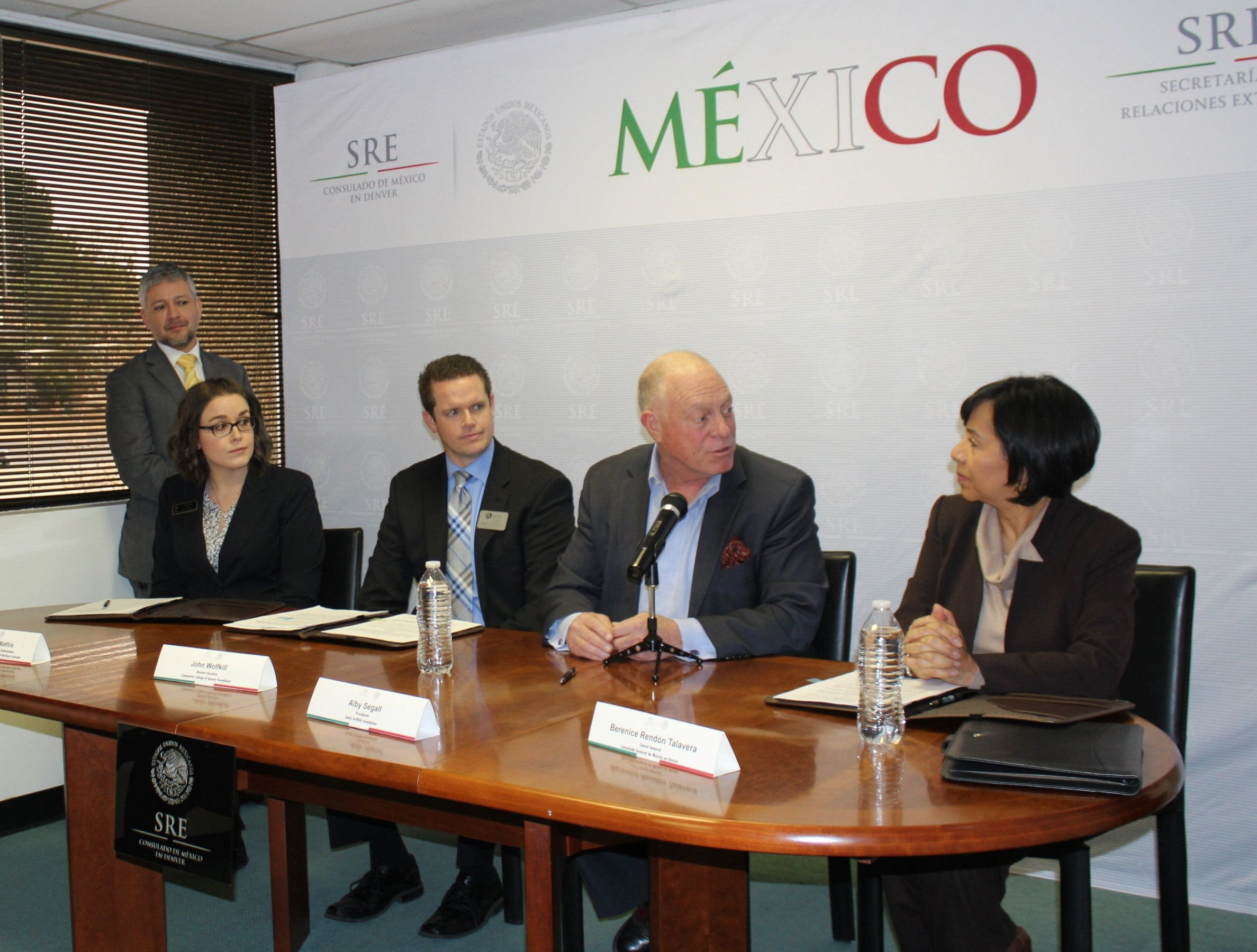 Consul General of Mexico, Berenice Rendón Talavera, signs a Memorandum of Understanding with Emily Griffith Foundation President, Alby Segall, at her left.