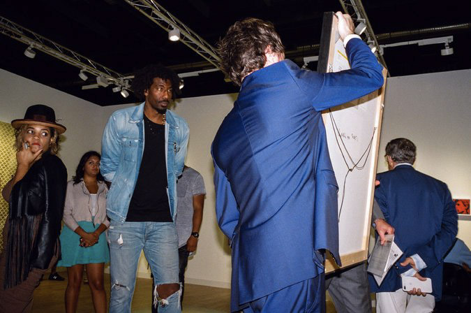 Former Knick Amar'e Stoudemire, who has amassed a notable art collection, at Art Basel in Miami in December. Credit Daniel Arnold for The New York Times