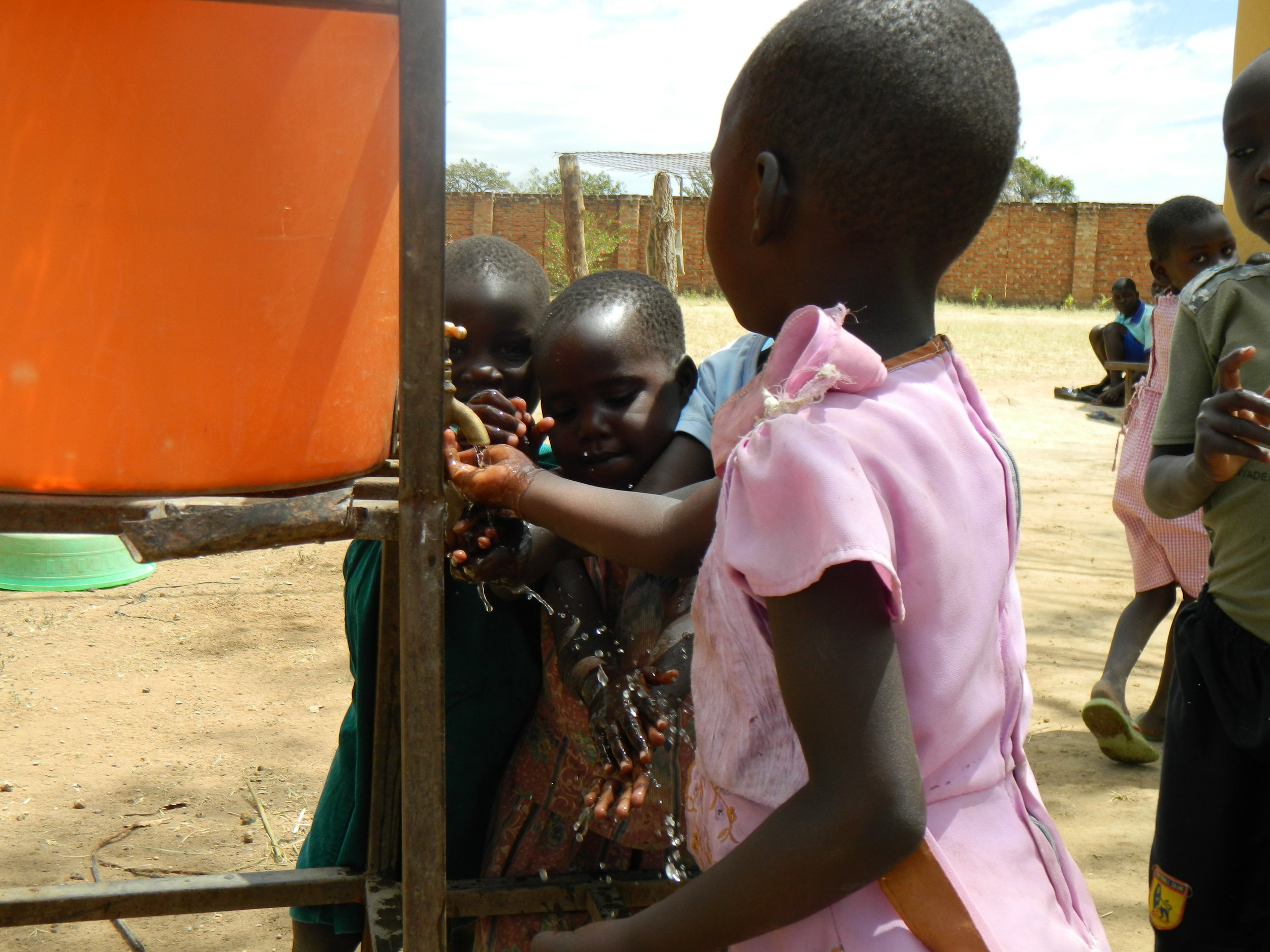 The kids in Uganda washing their hands before lunch