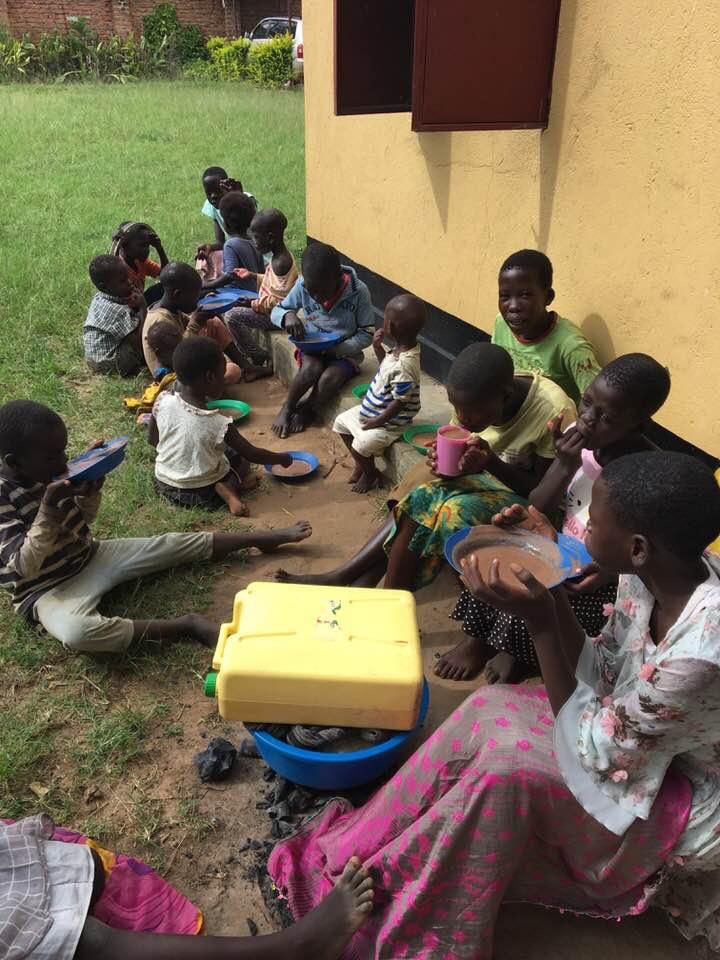 Kids eating millet porridge for breakfast