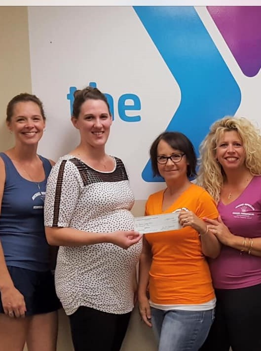 A check being presented to the Genesee County YMCA Challenger Program for $1,000.   L to R: Board Member Ellen DellaPenna, YMCA Challenger & Aquatics Coordinator Megan Boring, Board Members Donna Kabel and Diane Hale