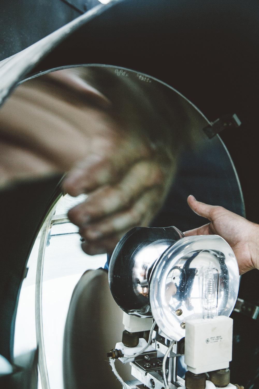 EM1 Tony Robb inspects the light at Portland Head Light. Photo © Jenny Rebecca Nelson