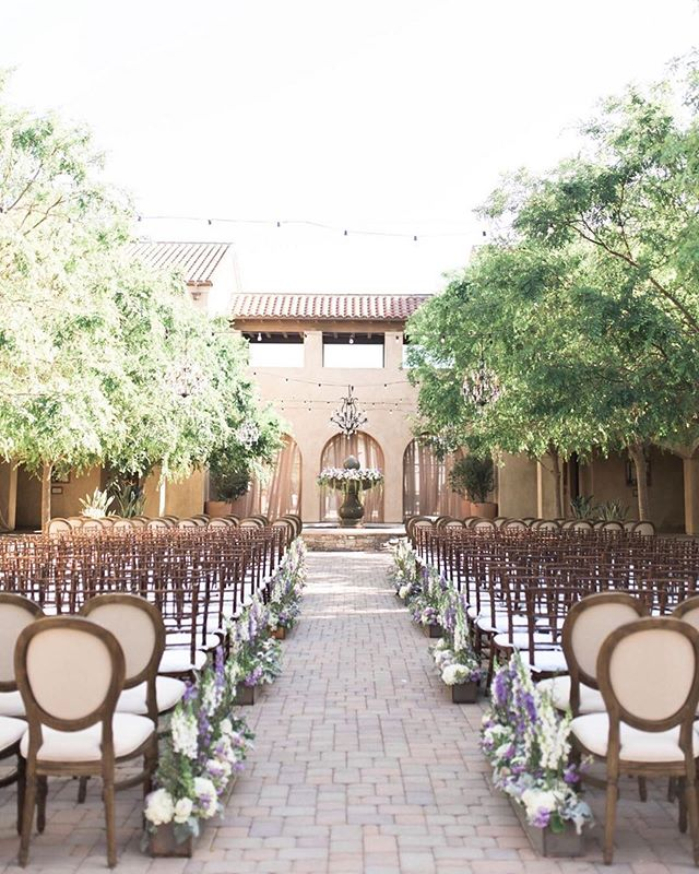 We adore this soft neutral palate in the plaza. Sweet summertime vibes 💕. #Repost @hellobluephoto ・・・ Outdoor ceremonies filled with lavender and greenery 🌿 Planning @asterandpark Venue @serraplaza  Photography @hellobluephoto Videography @618studios  Rentals @sigpartyrentals  @latavolalinen  Bridal Details @badgleymischkabride @the_mrs_box