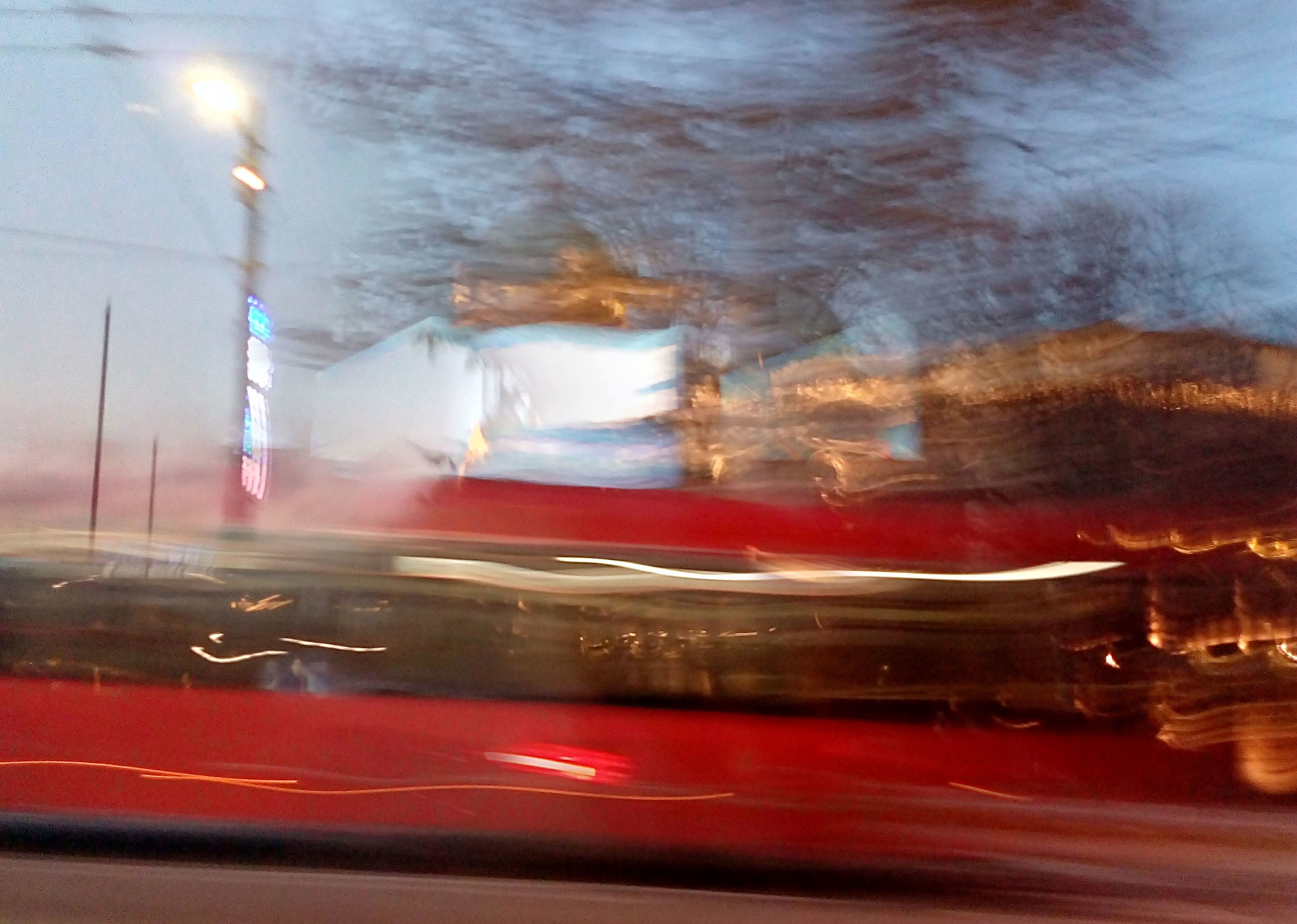A bus zooming by, photo by Aleks