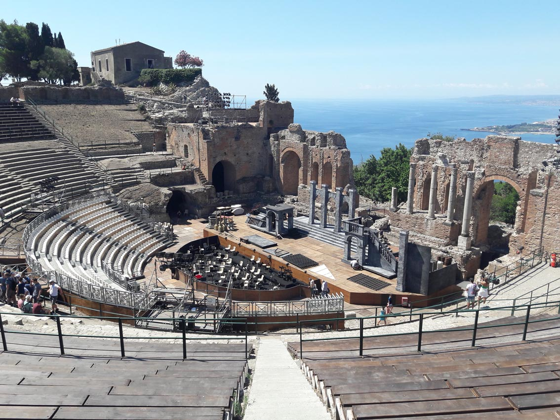 Ancient Theatre in Taormina. The modern stage is being prepared for a performance