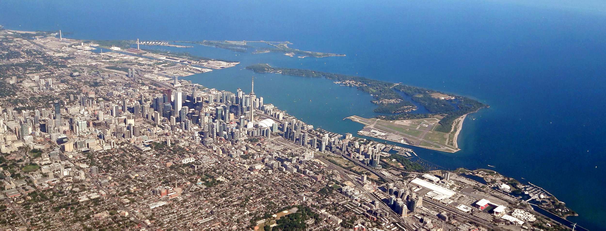 Flying into Toronto Airport. The CN Tower towers above the city.