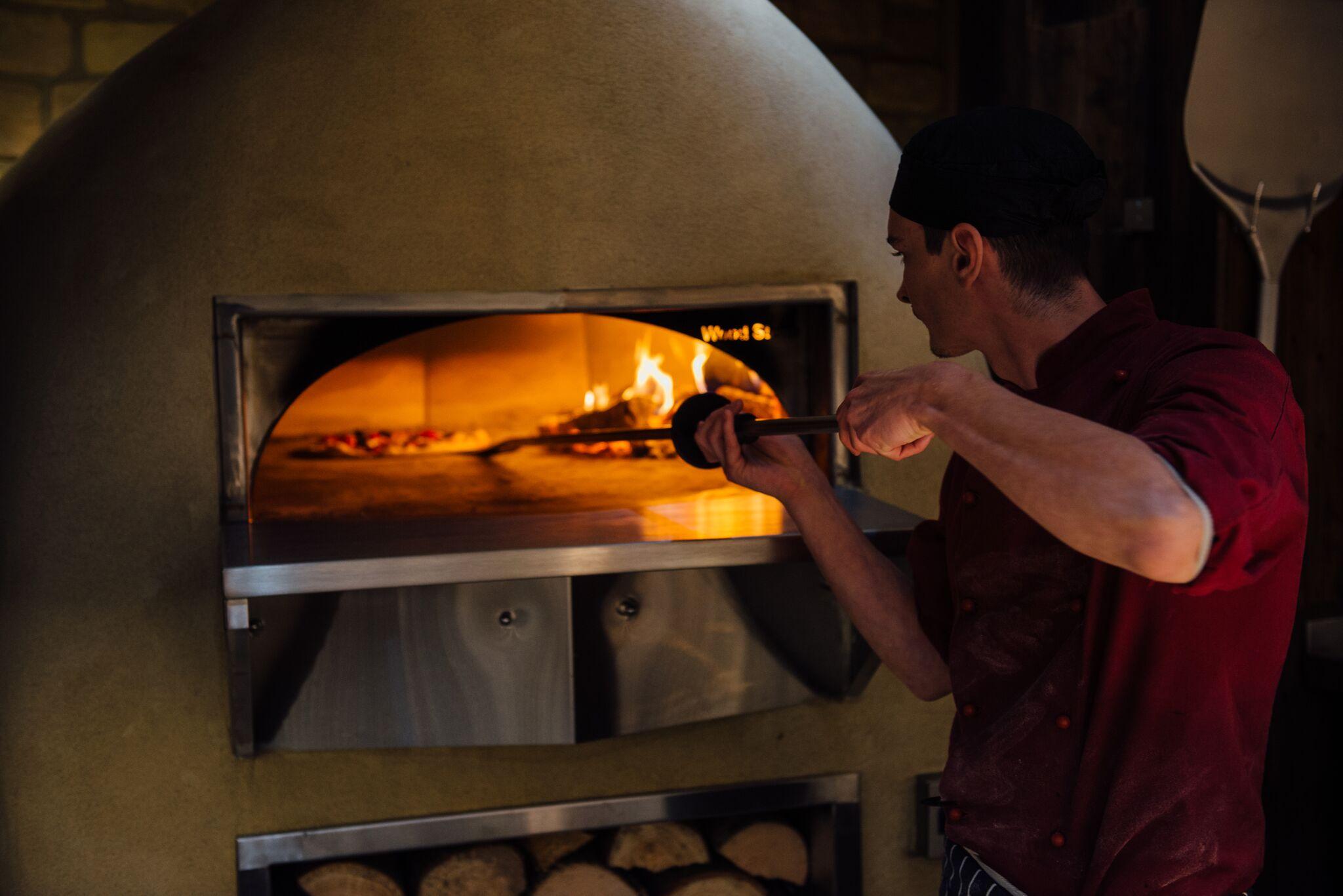 Blue Boar Kitchen Pizza Oven w: Chef 2.jpg