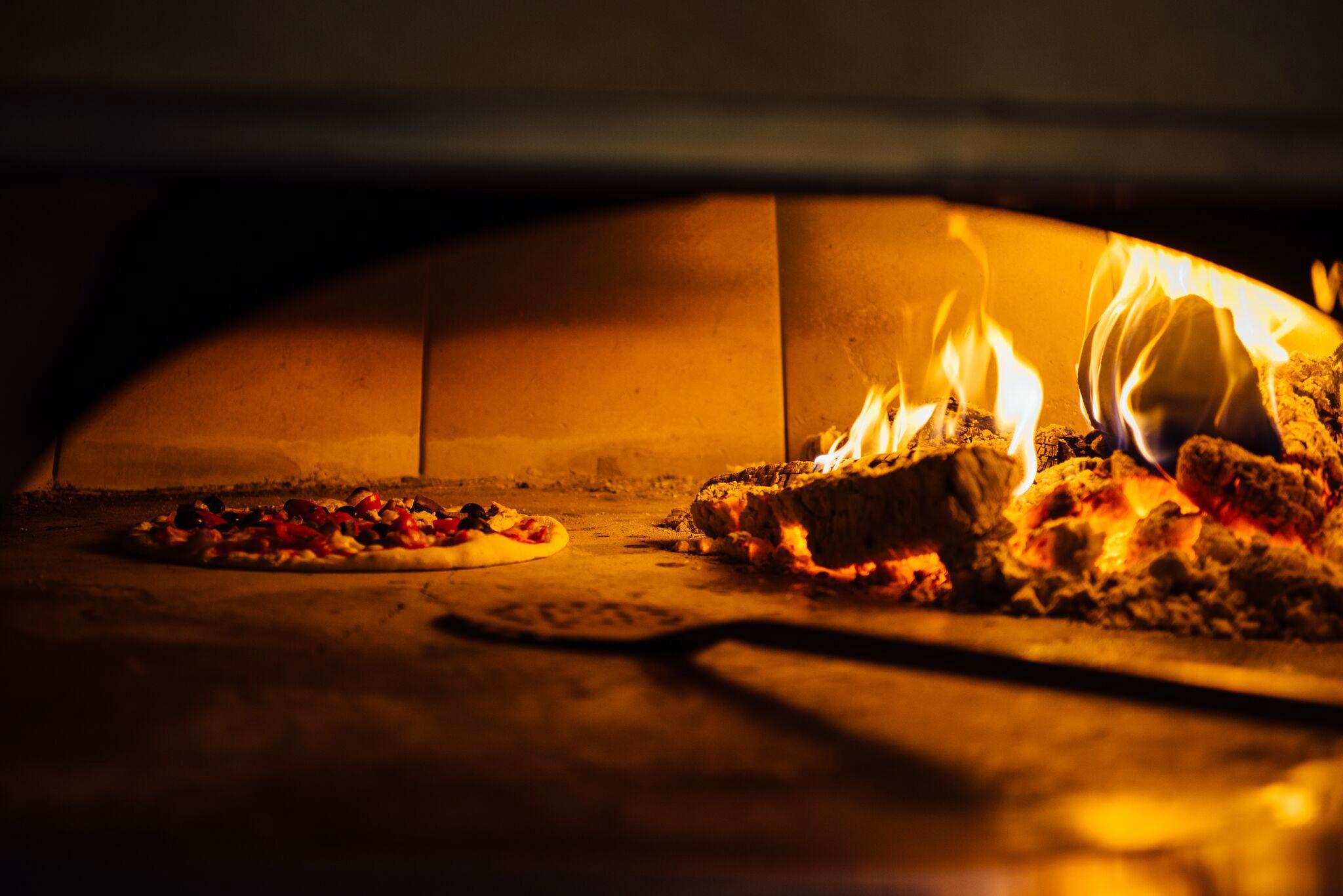 Blue Boar Kitchen Pizza Oven w: Chef 3.jpg