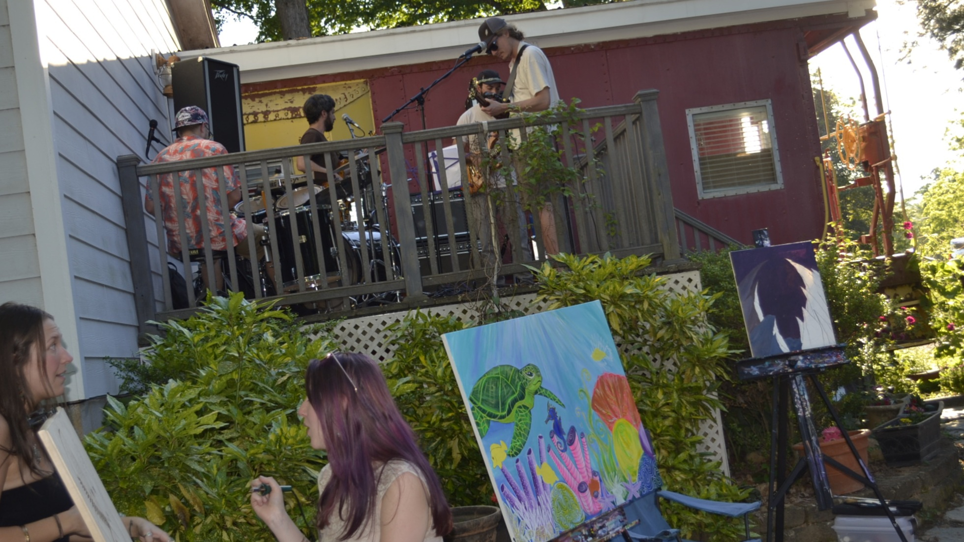 Book Your Event Here - This magical backyard has a deck perfect for live music, 1200 sq. feet of rock terrace, a rec barn, ping pong table, lawn games, hot tub, and a converted school bus-turned-RV that doubles as a podcast studio and hangout space.