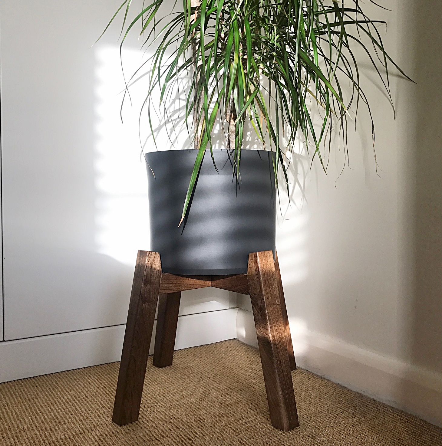 Collaboration - Whilst production is down to me, the design process should be a collaboration between myself and the customer. This plant stand was inspired by one found in a magazine by the customer.  I designed the structure based on the customers brief and the existing plant pot.  The English walnut used works beautifully with the black ceramic pot.