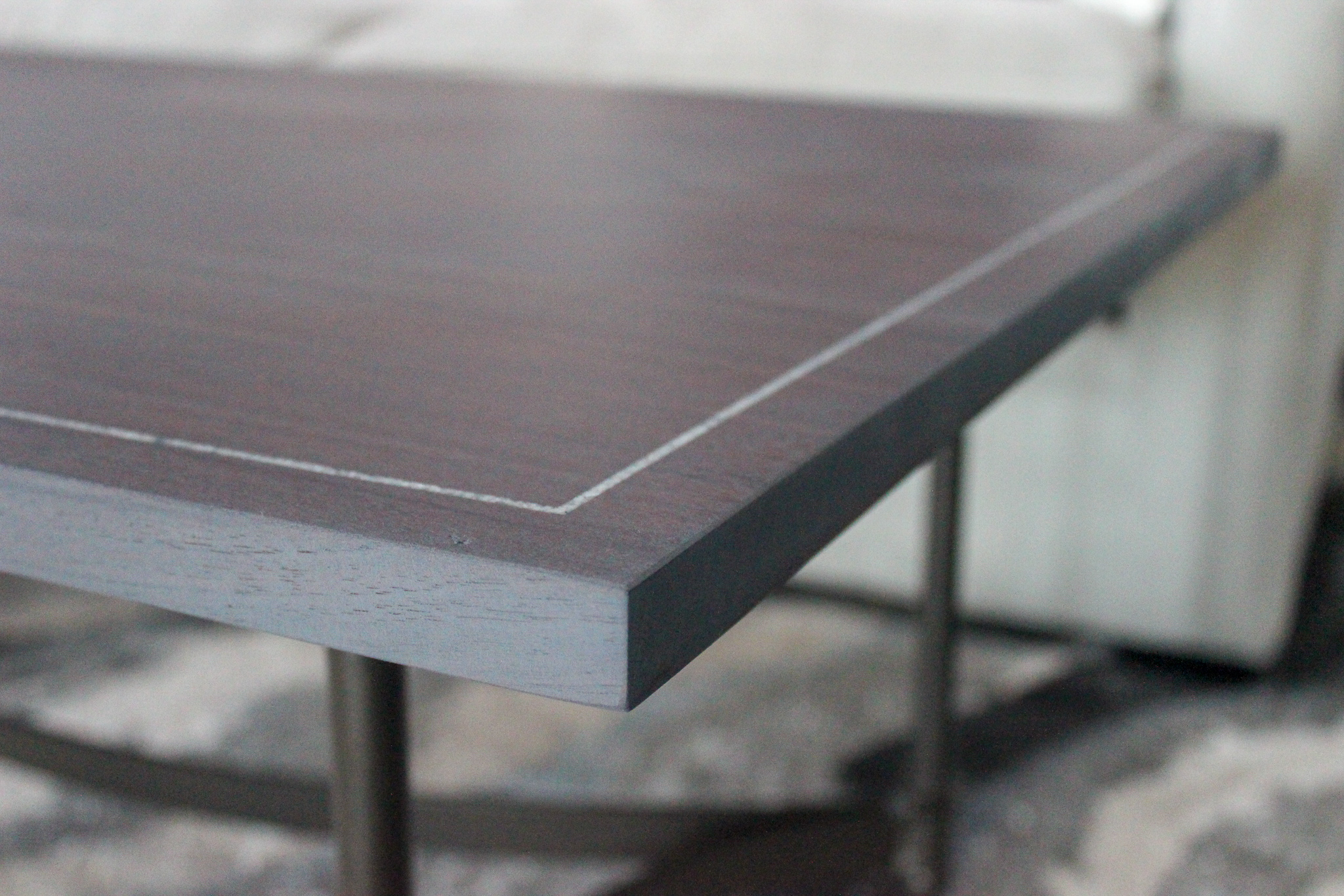 custom walnut tabletop with mother of pearl inlay