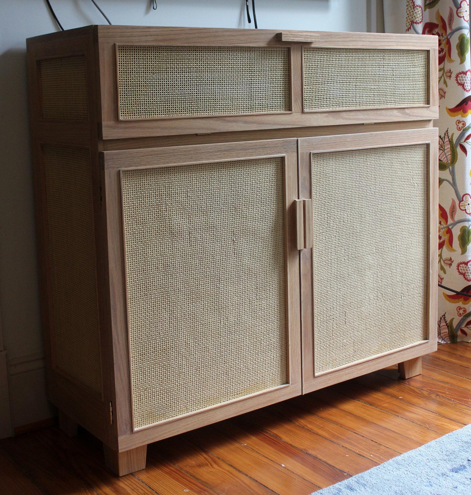 custom white oak media cabinet with cane
