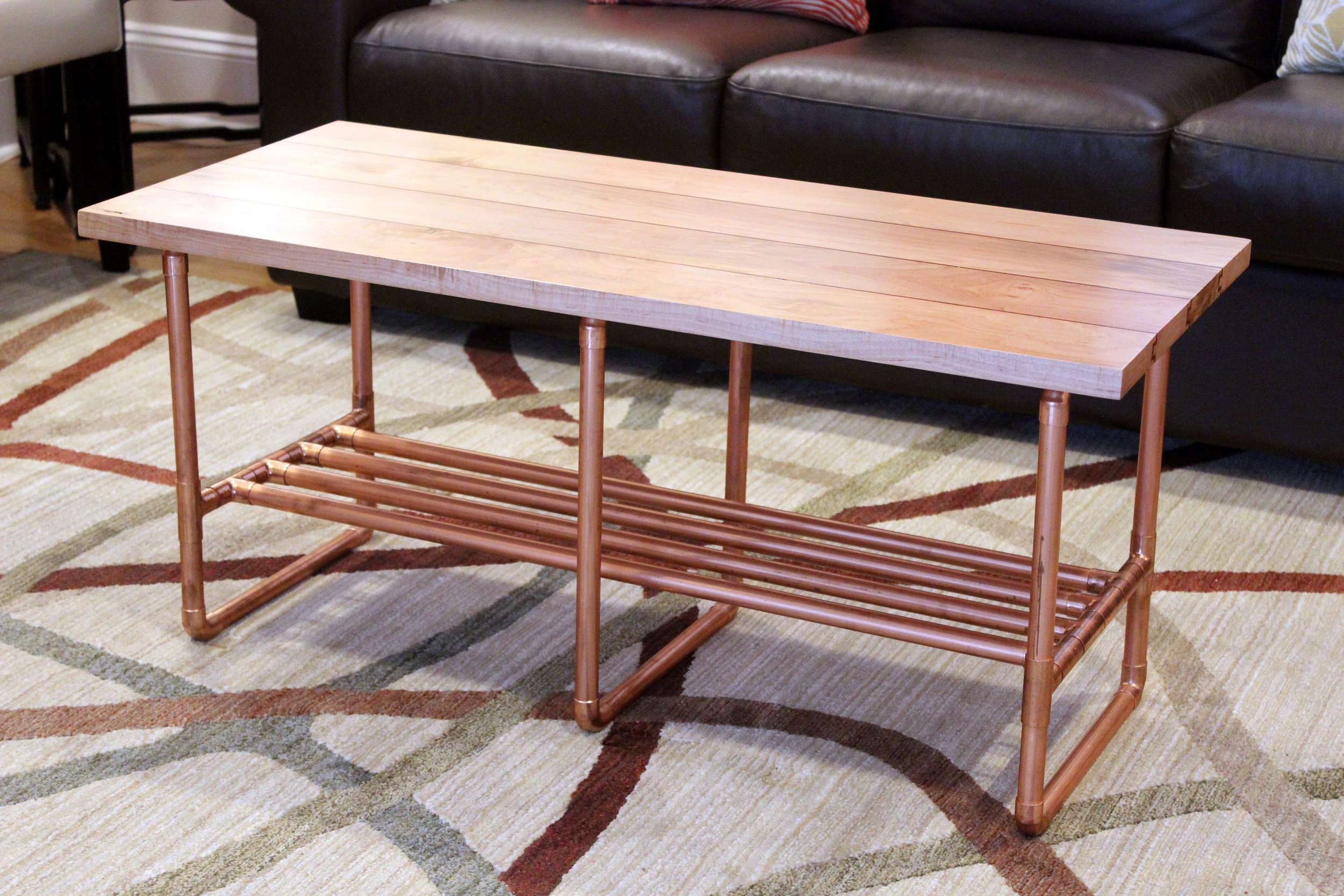 custom maple coffee table with copper inlay and copper pipe legs