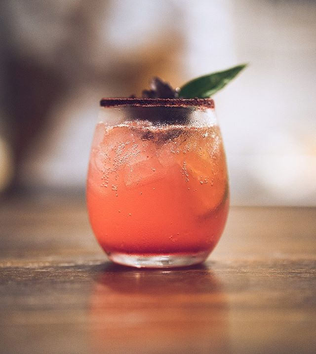 Drink One. Brookies Gin. Homemade elderberry + persimmon syrup. Fresh lime. Cranberry Hibiscus around the rim. Lemon myrtle leaf. 📷@wovenmotion