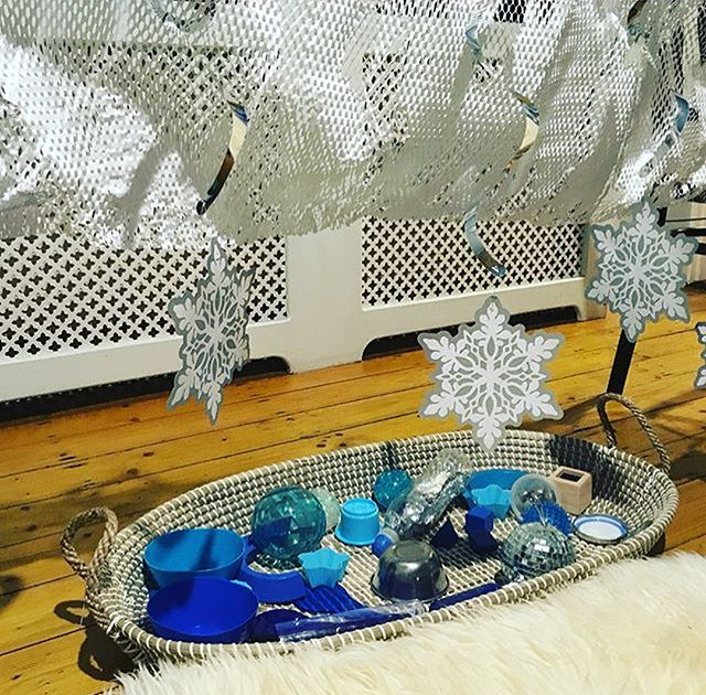 @naptimewonders on Instagram shared this wonderful sensory baby invitation to explore for our snow theme this week. She compiled blue and silver items in the basket, these are for feeling and mouthing. Then above she laced paper netting and decorations to pull and look at. The fur blanket is also a lovely addition. We love seeing how you include even the smallest sensory kids in our themes!
