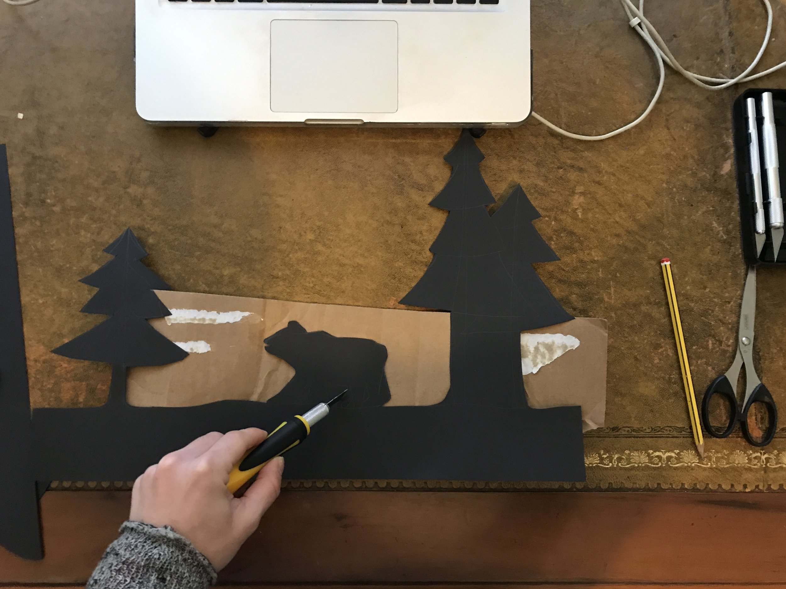 I drew out my Icelandic silhouette scene onto black card. I believe you can't have light without dark. It adds contrast and is totally mesmerising. I used scissors and a craft knife to create the foreground.