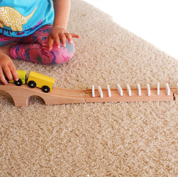 Train Track Dominoes - Set off your lined up dominoes using your train and track!@acraftedchildhood