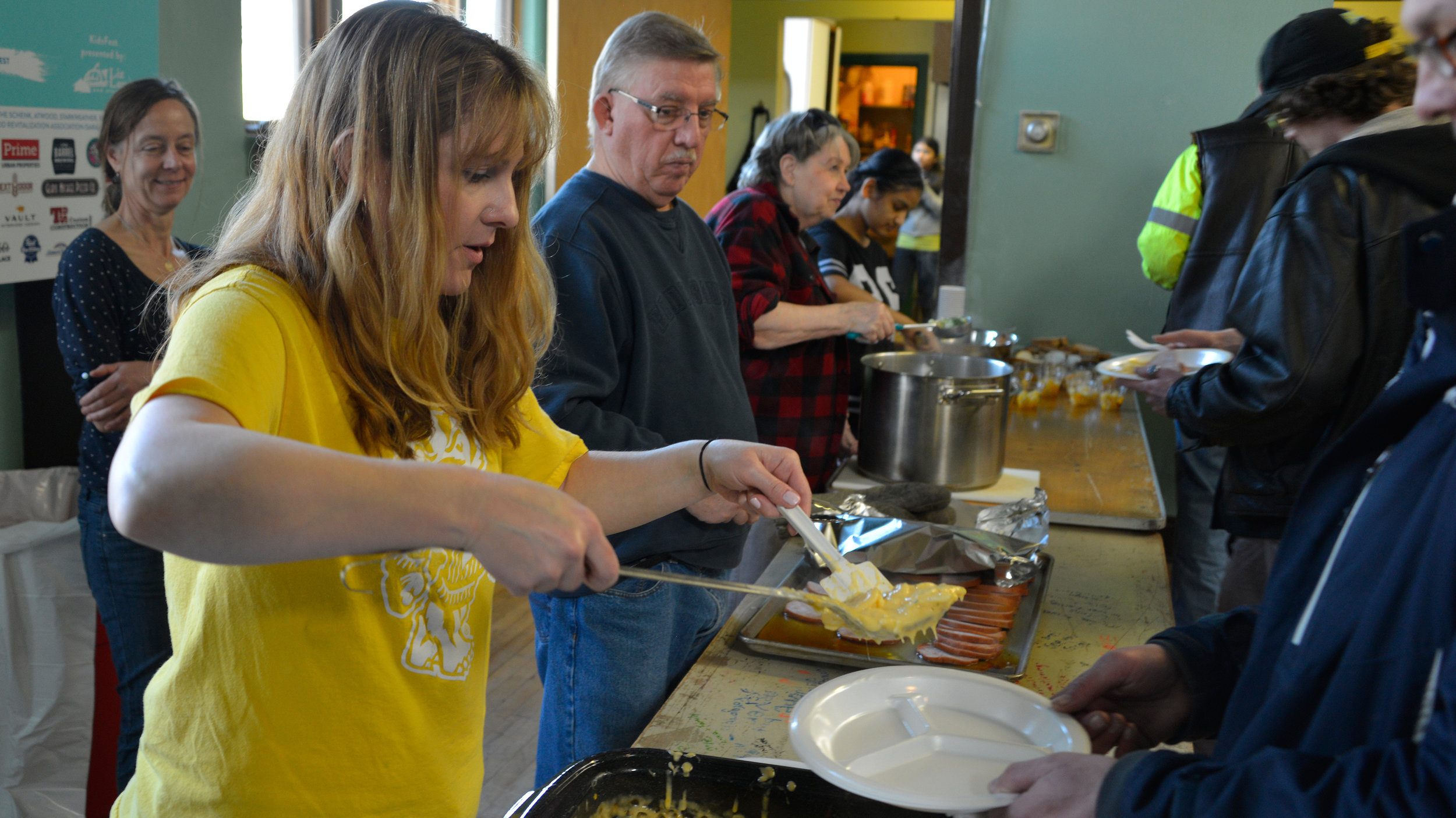 Volunteers serve up a hot meal during the Saturday Free Community Meal, offered every Saturday from 11:30 a.m. - 12:30 p.m.