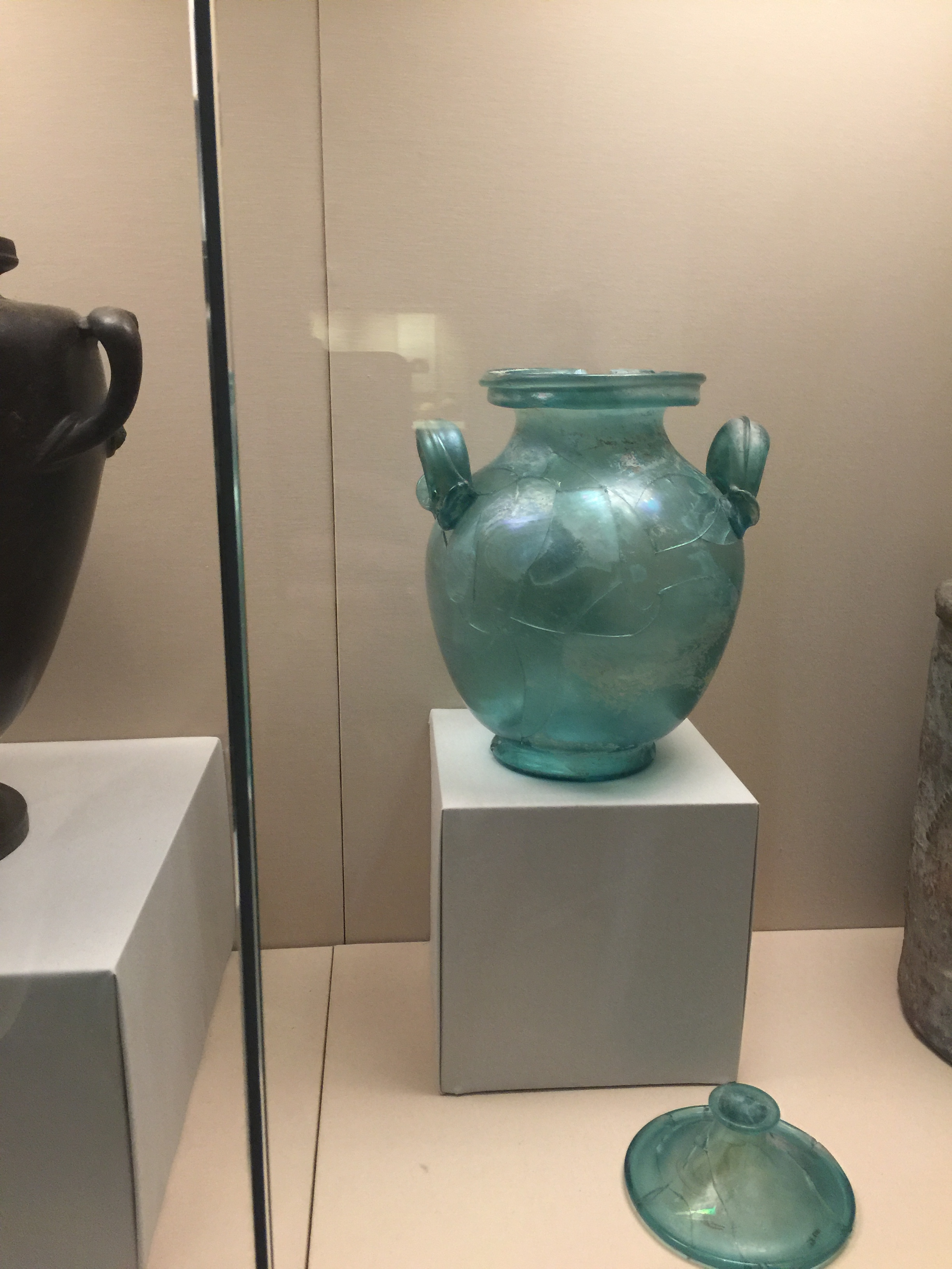 Glass urn originally used to protect cremated bones, from Warwick Square, London, 1st century AD