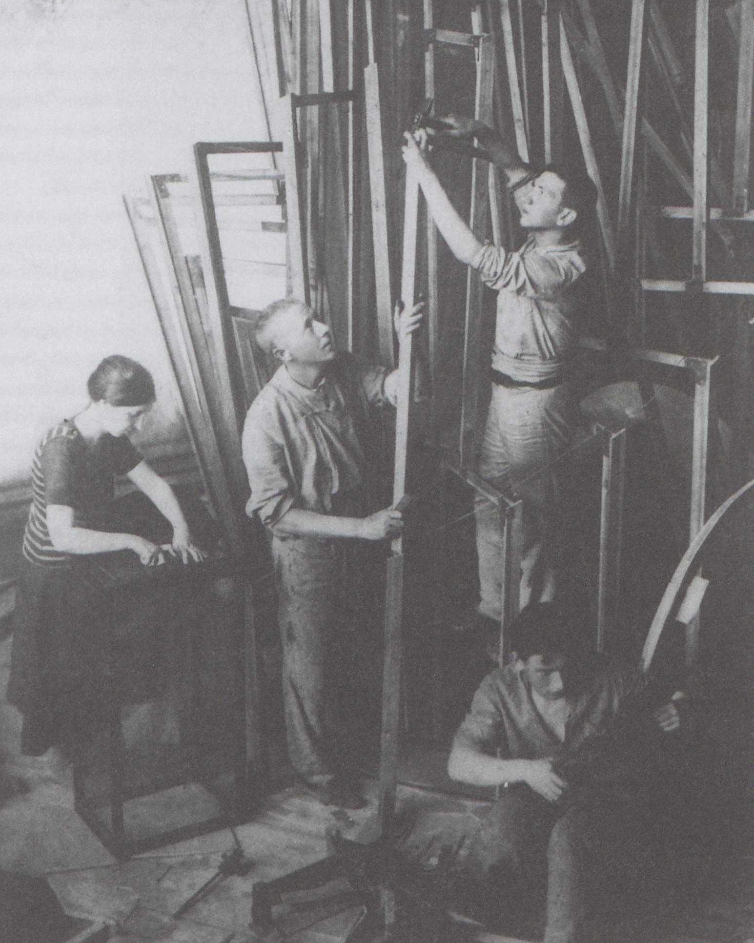 Tatlin working with his assistants to build the first model of the  Monument to the Third International , Petrograd, Soviet Union, 1920