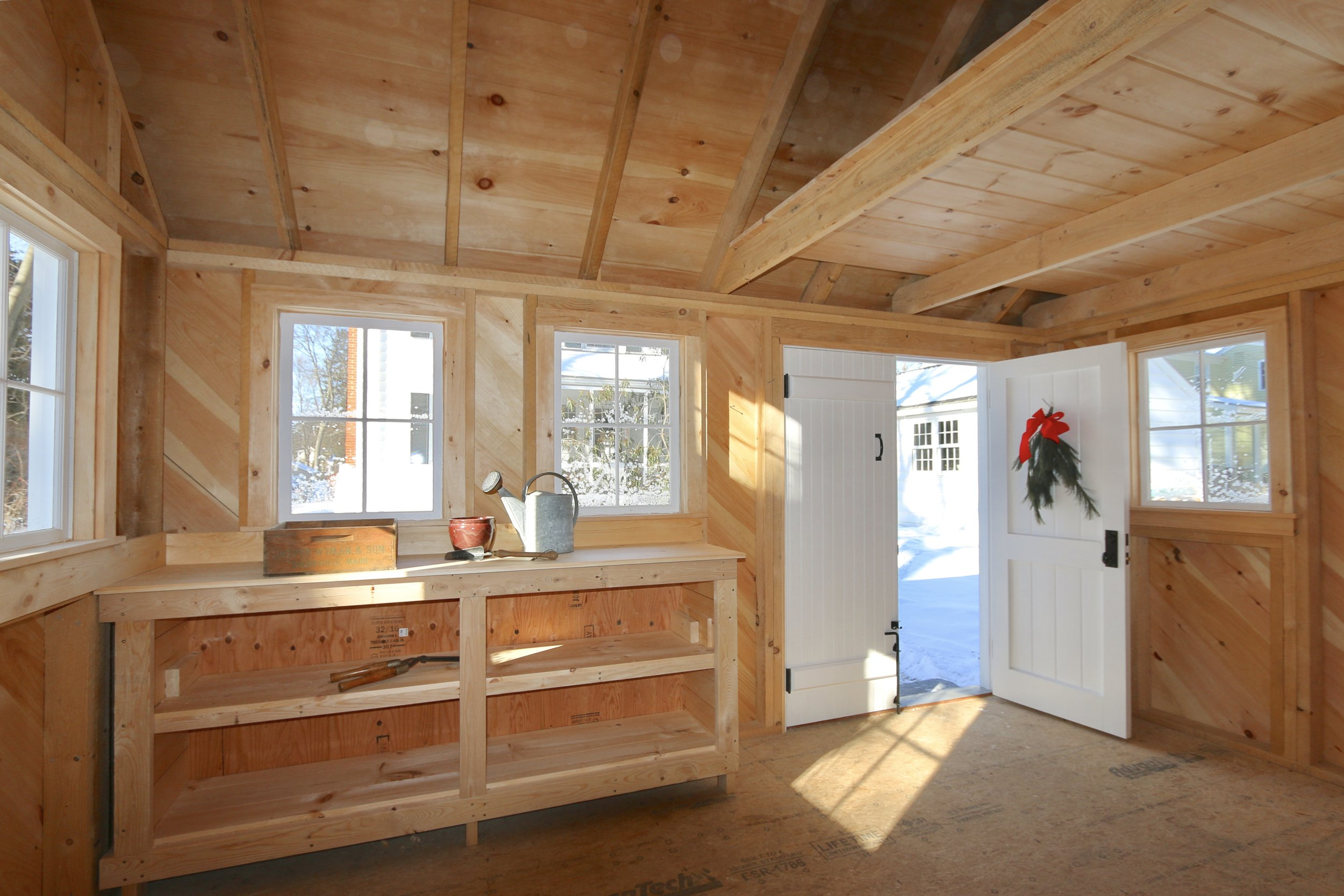 I nterior of New Garden Shed built with Rough Sawn Lumber to resemble typical outbuildings of days gone buy. Rough Sawn Lumber is 25% larger in dimension than todays'store bought lumber. It presents a robust feeling and looks so much more substantial. Timeless!!