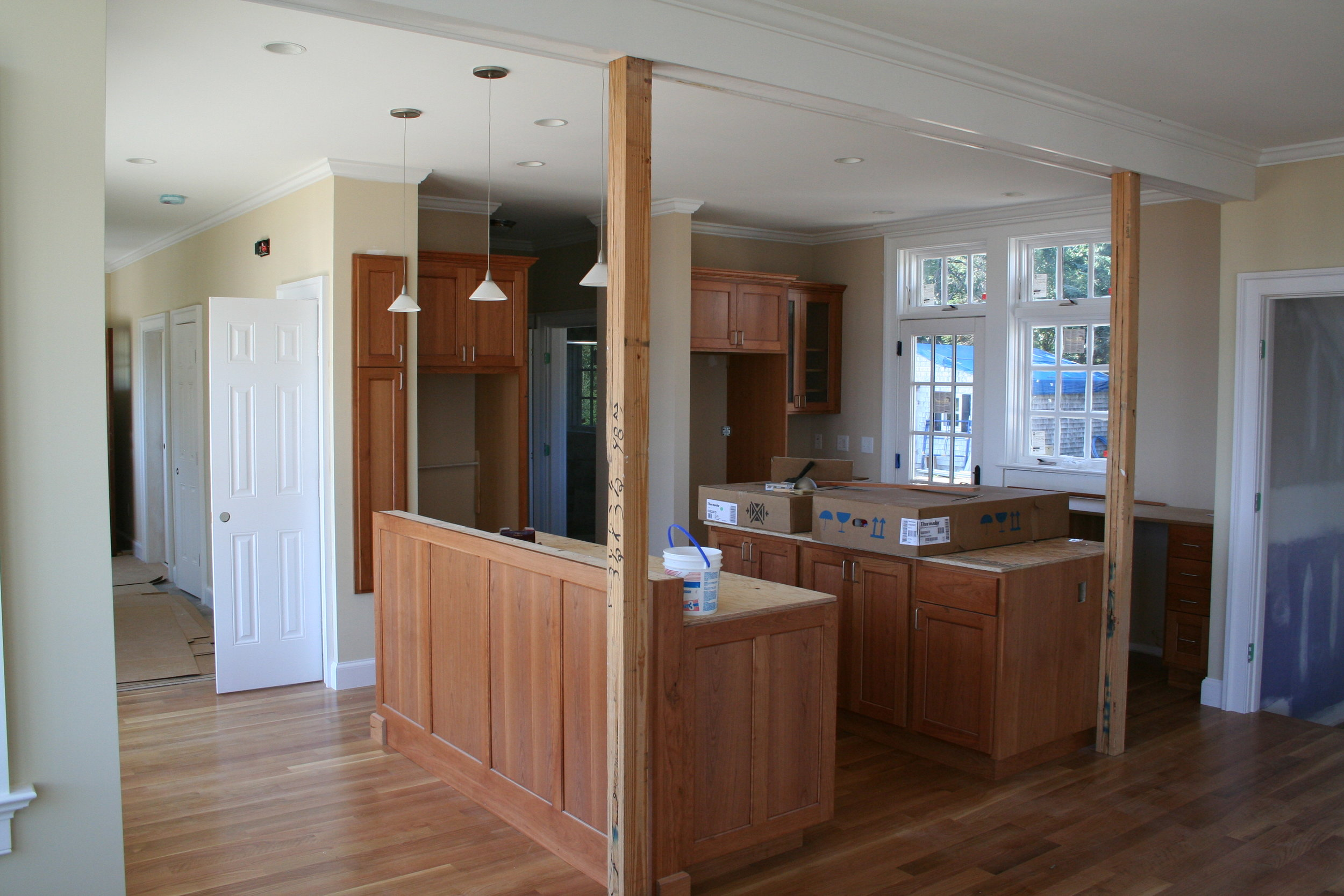 Another kitchen nearing completion. Cherry cabinets, quarter sawn white oak flooring.