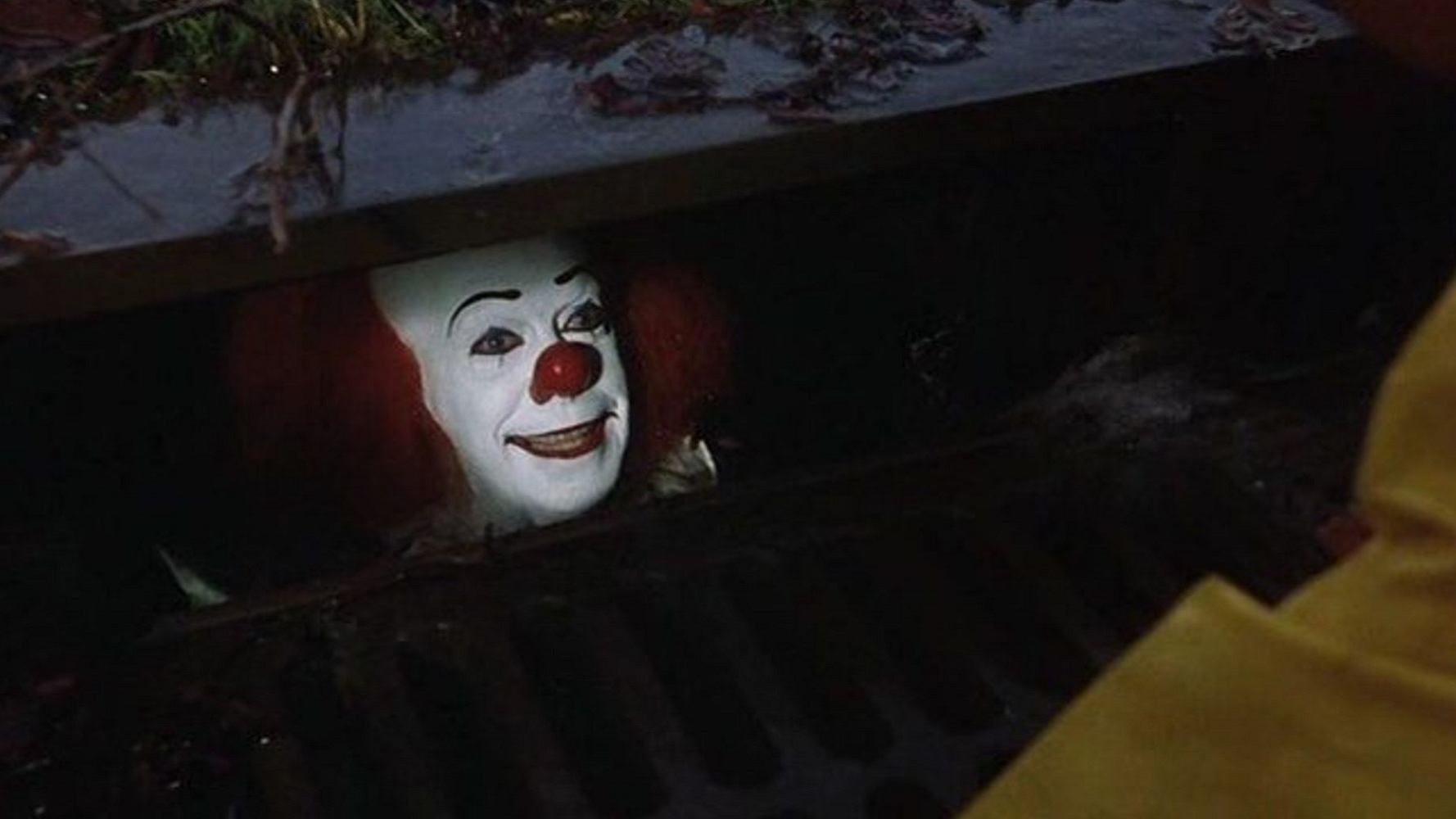 Stephen-Kings-IT-Pennywise-down-the-storm-drain.jpg