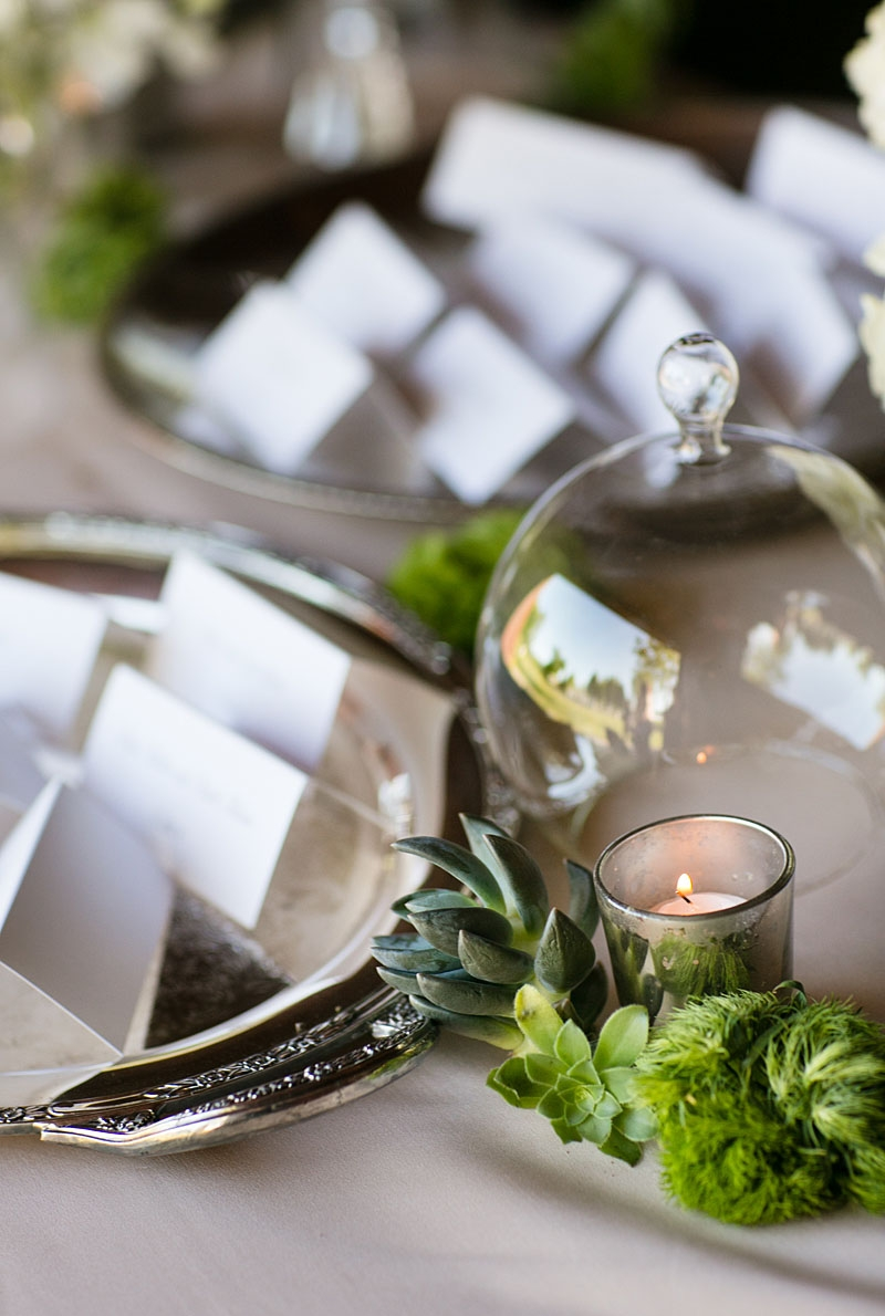 5. Dainty Decorations:   It can be easy to forget the small spaces and neglect embellishing the guest book sign-in table, the cake table, buffet tables, or even the bar area. However, these dainty decorations couldn't be more crucial to making or breaking the entire atmosphere! Let your details and design continue down the buffet line or to the bar with small embellishments, splashes of color, sprinkles of flower petals, or themed trinkets.