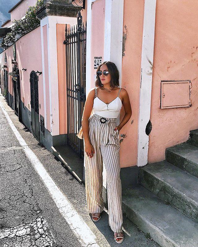 || Positano, you're beautiful || Pants: @nanushka  Top: @houseofharlow1960  Sandals: @chanelofficial  Sunglasses: @prada