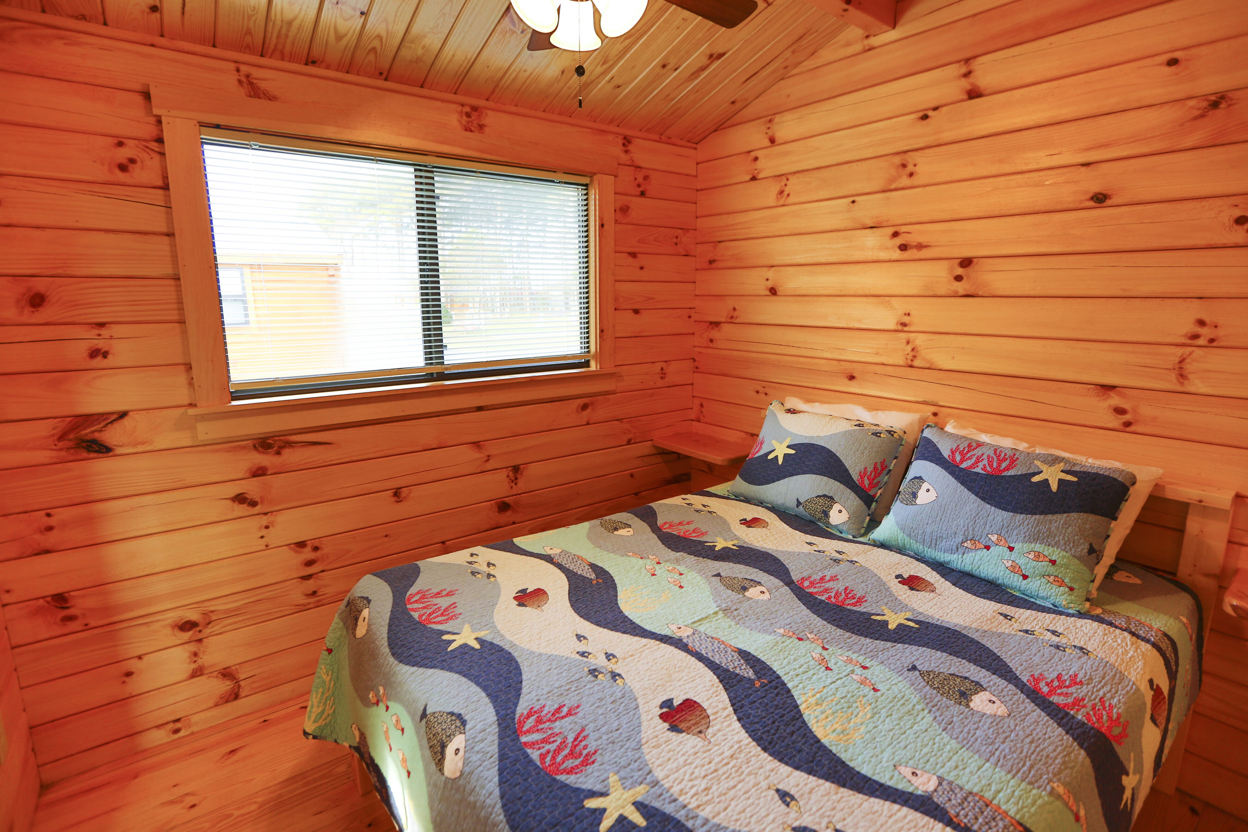 Lakefront Cabins Master Bedroom | Treasure Beach
