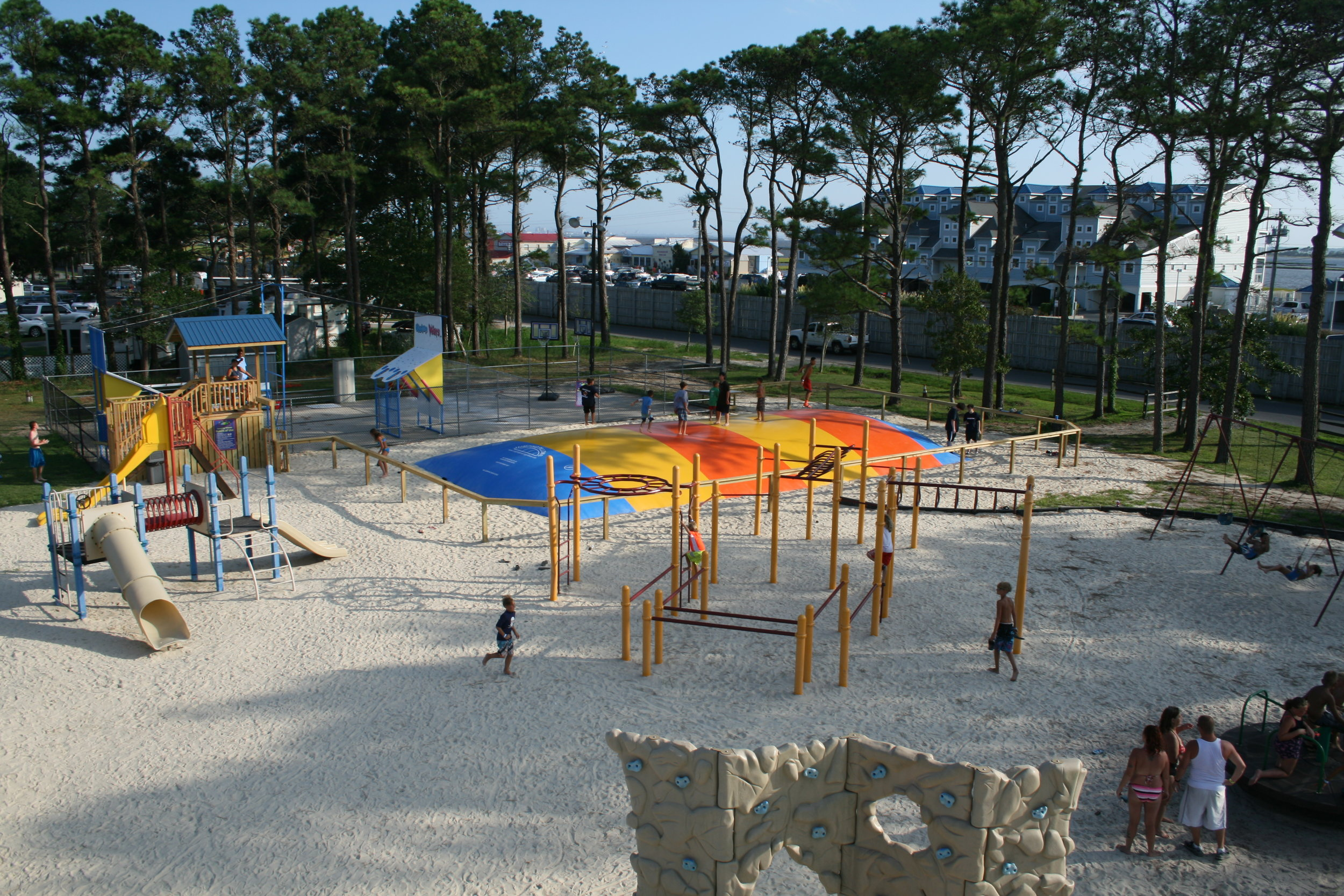 Play Here - Water wars, giant jumping pillow, lighted basketball court, horseshoes, cornhole, playground, bike rentals & more!